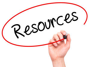 Man Hand writing Resources with black marker on visual screen. Business, technology, internet concept.
